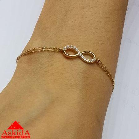 золотой браслет со знаком бесконечности